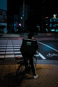 Ubereats delivery bike rider looking to cross the street